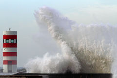 Storm waves over lighthouse. Storm wave over lighthouse of Porto Stock Photo
