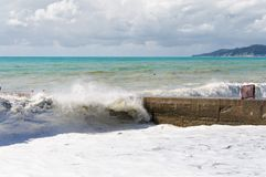 Storm waves roll on the breakwater. Stock Image