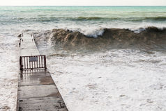 Storm waves roll on the breakwater. Royalty Free Stock Image