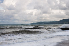 Storm waves roll on the breakwater Stock Photography