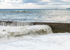 Storm waves roll on the breakwater Royalty Free Stock Image