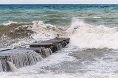 Free Storm Waves Roll On The Breakwater Stock Photos - 55993263