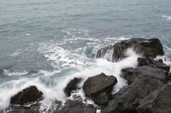 Storm. Waves and sea foam. Sea waves hitting the rocks, in the cold sea Royalty Free Stock Photos