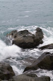 Storm. Waves and sea foam. Sea waves hitting the rocks, in the cold sea Royalty Free Stock Images
