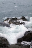 Storm. Waves and sea foam. Sea waves hitting the rocks, in the cold sea Stock Photo