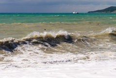 Storm waves on the sea shallows. Royalty Free Stock Photos