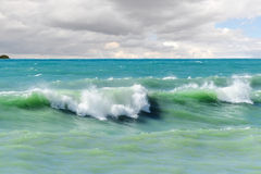 Storm waves on the sea shallows. Stock Photos