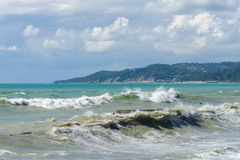 Storm waves on the sea shallows. Royalty Free Stock Image
