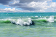 Storm waves on the sea shallows. Royalty Free Stock Photography
