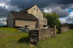 Storm Weather Clouds over a Barn in the country. Images taken of Lord Stirling's Barn in Valley Forge National Park. There are very dark clouds due to the rain royalty free stock photos