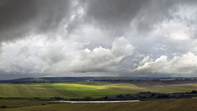 Storm weather. Field and lake during storm weather Stock Photography