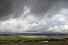 Storm weather. Field and lake during storm weather Stock Image