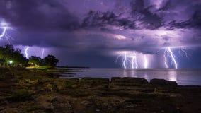 Storm, wind, lightning at sea Stock Photos