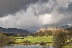 Stormachtige hemelen over Langdale Stock Foto's