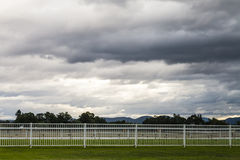 Stormclouds at Dusk Over an Empty Horse Racetrack Royalty Free Stock Images