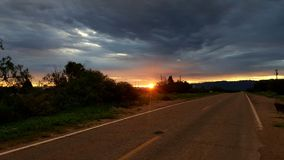 stormig soluppgång Arkivbild