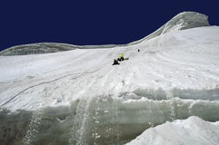 Storming. A group of mountaineers storming an ice wall Stock Images
