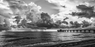 Storming the Pier. Storm on the horizon in south Florida.  Thunderstorms in the afternoon are quite the norm, especially int he summer months Royalty Free Stock Photos