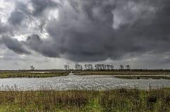 Stormmoln över en naturö royaltyfria foton