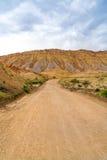 Stormmoln och grusväg i sydliga Utah Fotografering för Bildbyråer