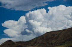 Stormmoln som stiger ned på helvetekanjonen Royaltyfria Bilder