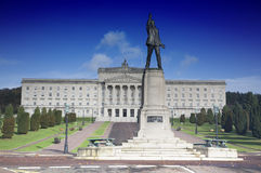 Stormont buillding. Exterior of Stormont building with Edward Carson statue in foreground, Belfast, Northern Ireland royalty free stock photo