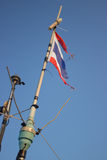 Storms battered the Thai flag on the mast Stock Photo