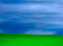 Storms and green grass grassy hills background royalty free stock image