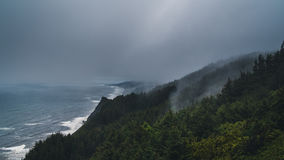 Storms rolling over the Oregon coastline. Stock Photos