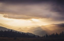 Prislop Pass. Storms at sunset seen from Prislop Pass Stock Photos