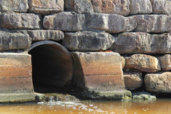 Stormwater drain. Rocky wall around storm water drain royalty free stock photography