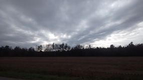 Stormy afternoon. Dark angry clouds on a dark afternoon Royalty Free Stock Photography