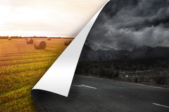 Stormy background over sunny landscape background Stock Photo