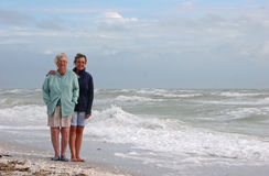 Stormy beach. Mother daughter afternoon stormy beach Sanibel Florida royalty free stock photo