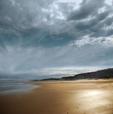Stormy beach. With dark clouds stock photography