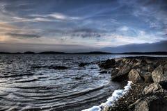 Stormy beach. A rocky, stormy beach at lake Saimaa royalty free stock image