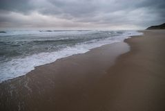 Stormy beach Stock Images
