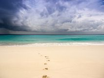 Stormy beach with footprints on the sand. See my other works in portfolio stock images