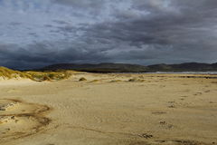 Stormy beach. With footsteps, Ireland stock photography
