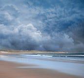 Stormy Beach scene. Dark blue stormy Beach scene royalty free stock image