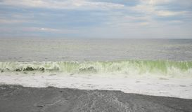 Stormy Black sea landscape and huge waves. A Stormy Black sea landscape and huge green waves in horizontal position Royalty Free Stock Photography