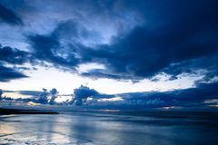 Epic Clouds over Kent. Stormy blue skies on the horizon on the North kent coast at Minnis Bay Royalty Free Stock Photography