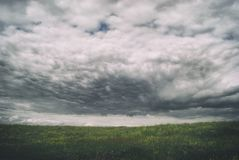 Stormy cirrus cumulus clouds over the vast green meadows. thunderstorm.  Stock Photography