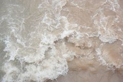Stormy clayey water in a river royalty free stock image
