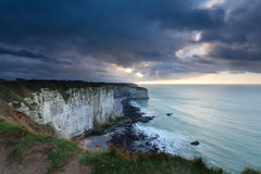 Stormy clouded sky over cliffs in ocean Stock Photo