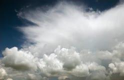 Stormy clouds. On dark blue sky background stock photo