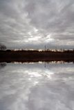 Stormy clouds. With reflection in water Royalty Free Stock Images
