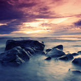 Stormy clouds. Sea and rock at the sunset Royalty Free Stock Image
