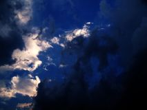Stormy Clouds. Light clouds and sky behind dark stormy clouds Royalty Free Stock Photography