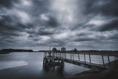 Stormy clouds above old concrete dam in Lithuania.  royalty free stock images